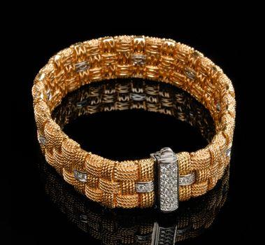 Golden bracelet with diamonds
