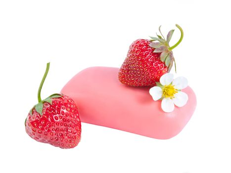 Natural soap with a strawberry and flower isolated on white background