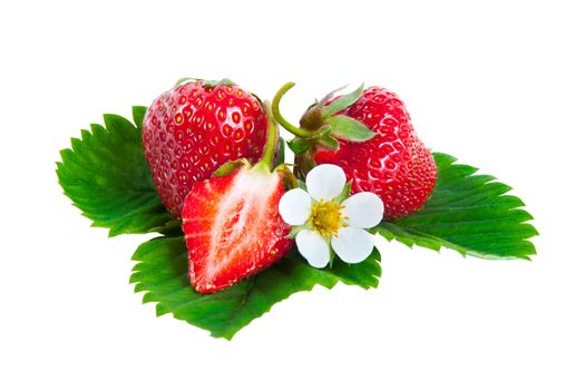Whole and half strawberries on green leaves with flower isolated on white background