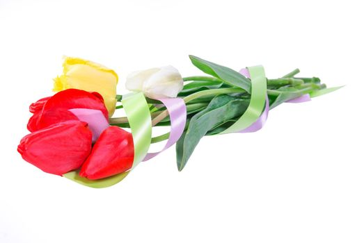 Beautyful bouquet of yellow, red and white tulips with tape isolated on a white background
