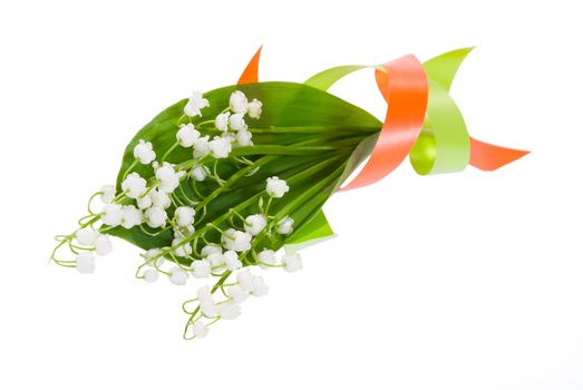 Bouquet of flowers lilies of the valley on leaf with color tape isolated white background