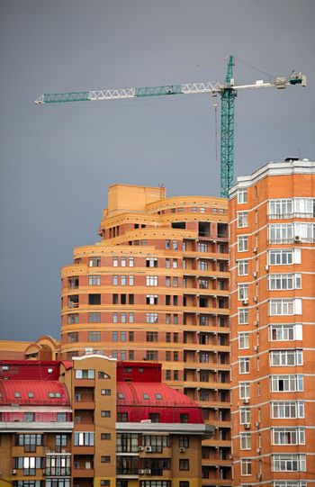 Abstract of  multi apartments building and crane in a sunset