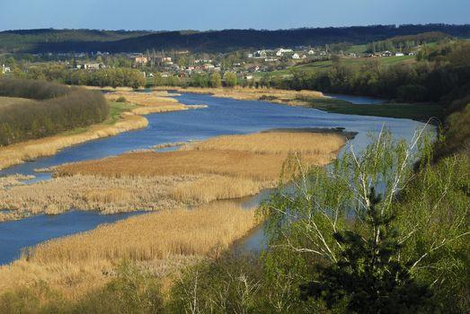village riverbank at spring
