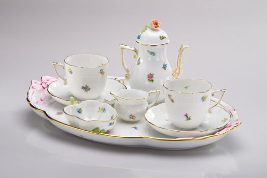 Hand painted tea service on white