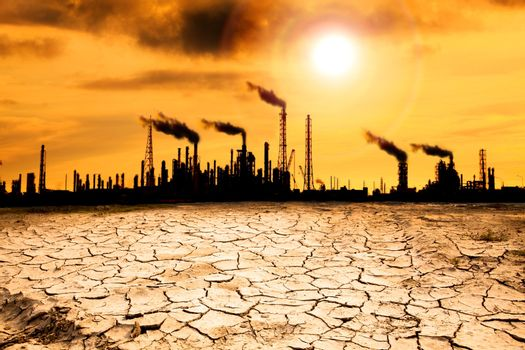 Refinery with smoke and global warming concept