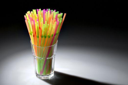 Multicolor flexible straws in the glass