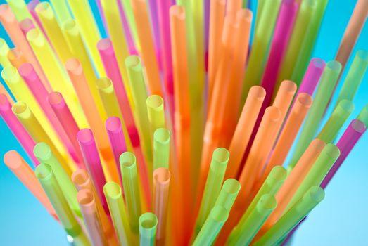 Multicolor flexible straws in the glass closeup