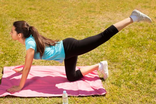 young beautiful woman stretching after sport outdoors