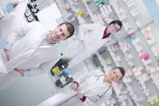 team of  pharmacist chemist woman and man  group  standing in pharmacy drugstore