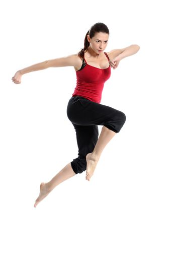 Girl in sportswear jumping jumping over white
