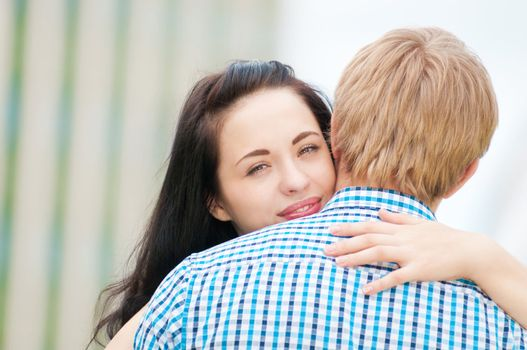 Portrait of a beautiful young happy smiling couple - hugging with love