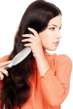 pretty woman combing hair