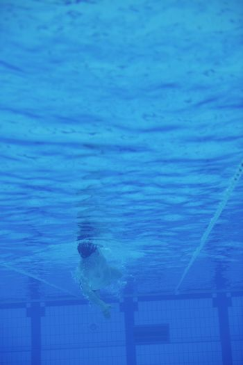 sport swimming pool  underwater with blue color and swimmers