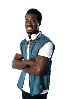 Man standing with headphones around his neck