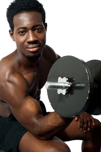 Powerful young man lifting weights