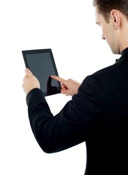 Man operating electronic digital device