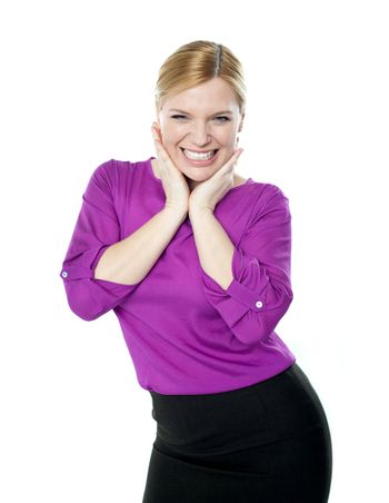 Excited woman posing with hands on chin