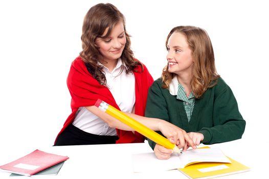 Girl explaining solution to her friend