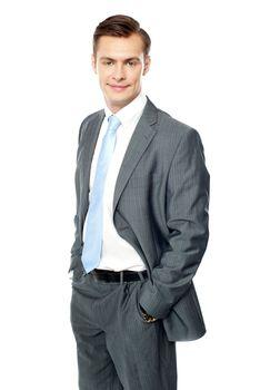 Smiling entrepreneur posing with hands in pocket