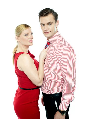 Woman grabbing man from his tie