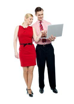 Female secretary pointing into laptop