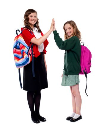 Students giving high five to each other