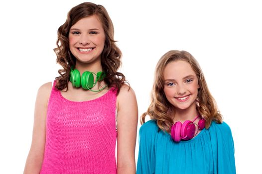 Teenagers posing with headphones around neck