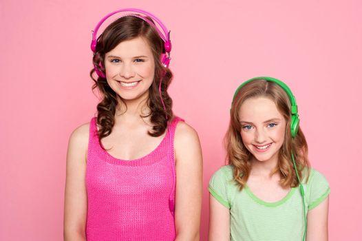 Smiling girls posing with headphone
