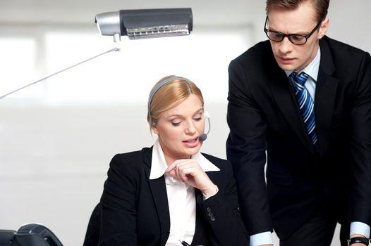 Female secretary explaining to boss