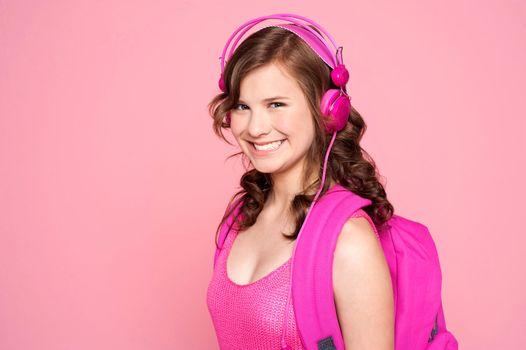 Attractive schoolgirl listening to music