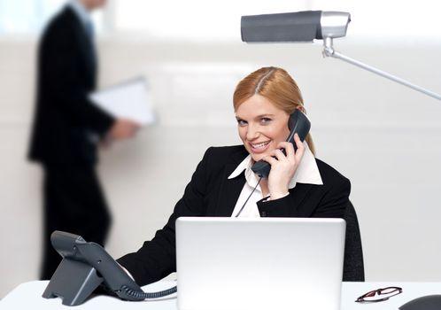 Attractive secretary attending phone call