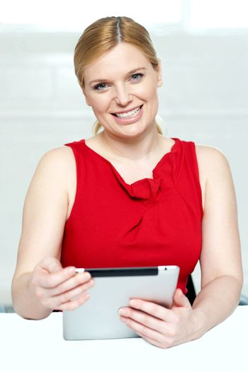 Beautiful young woman holding portable tablet pc