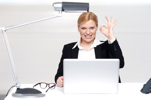 Corporate lady showing excellent gesture