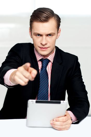 Tech savvy corporate man pointing at you