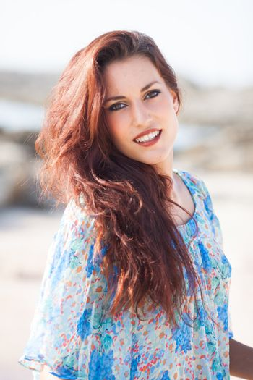 sexy beautiful woman portrait on the beach wearing a blue shirt