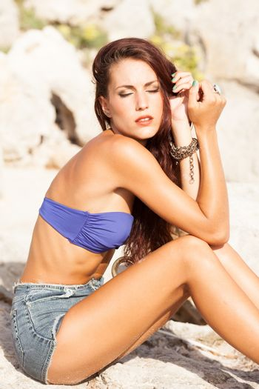 Sexy model posing on the beach fashion shoot on summer