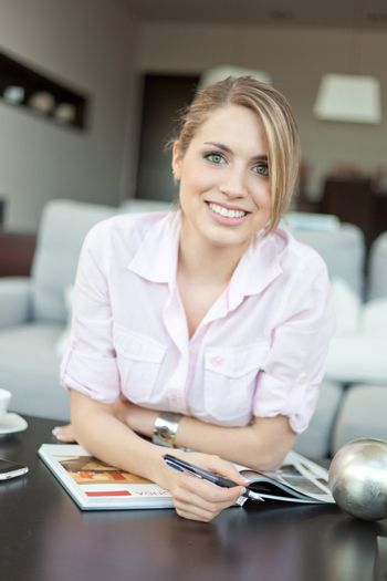 young beautiful woman with printed catalog