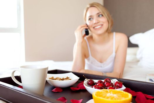 young beautiful woman using cellphone device during breakfast