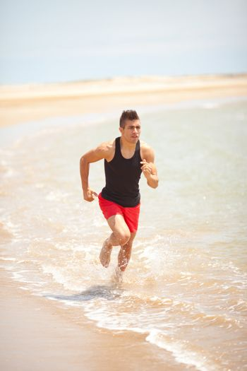 young handsome man jogging outdoors