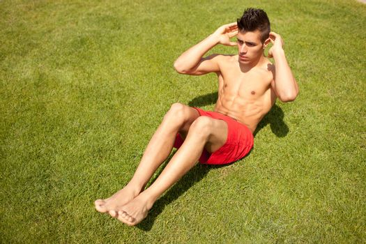 young handsome man making abs workout