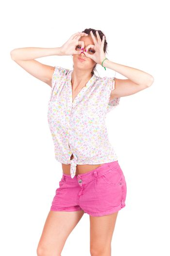 young beautiful women making googles gestures on face on white background