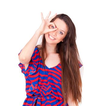 young beautiful women making hole gestures on face on white background