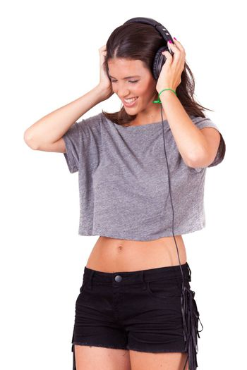 young beautiful women listening music on headphones on white background