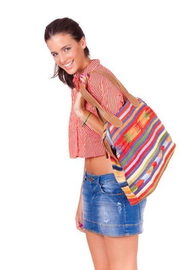 young beautiful women walking with a colorful bag on white background