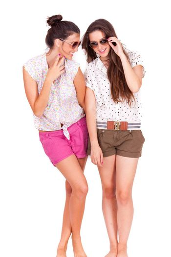young couple female friends laughing on white background