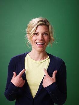 woman pointing at herself, studio shot