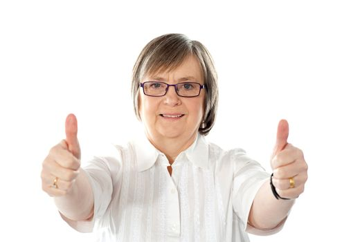 Female gesturing double thumbs up