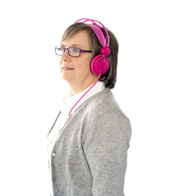 Aged female listening to music