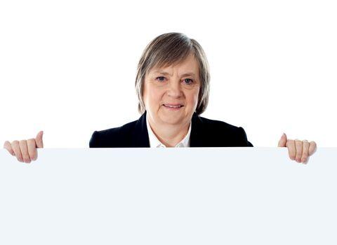 Female businessperson showing big ad banner