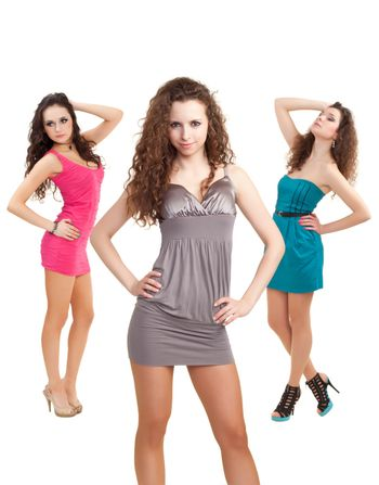 Image of three beauties in colorful dresses posing for photo